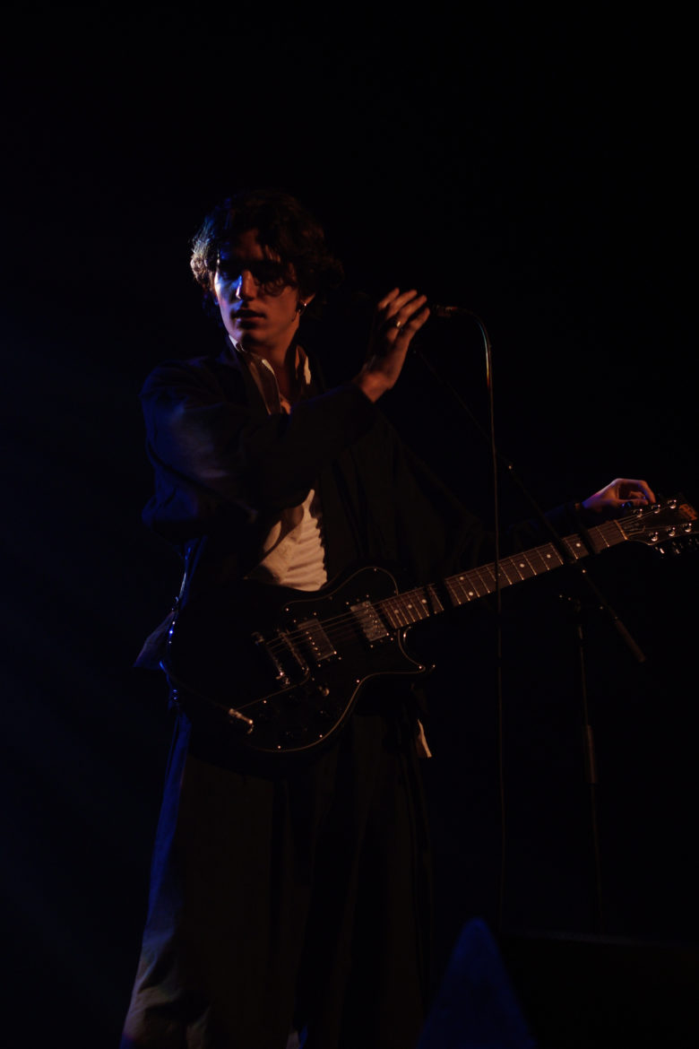 Tamino on stage playing the guitar