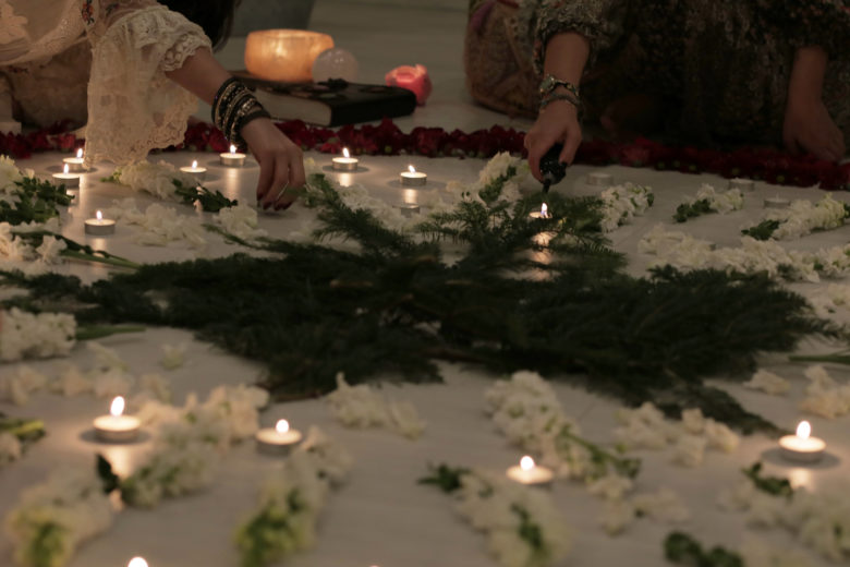 lit candles in a meditation gathering