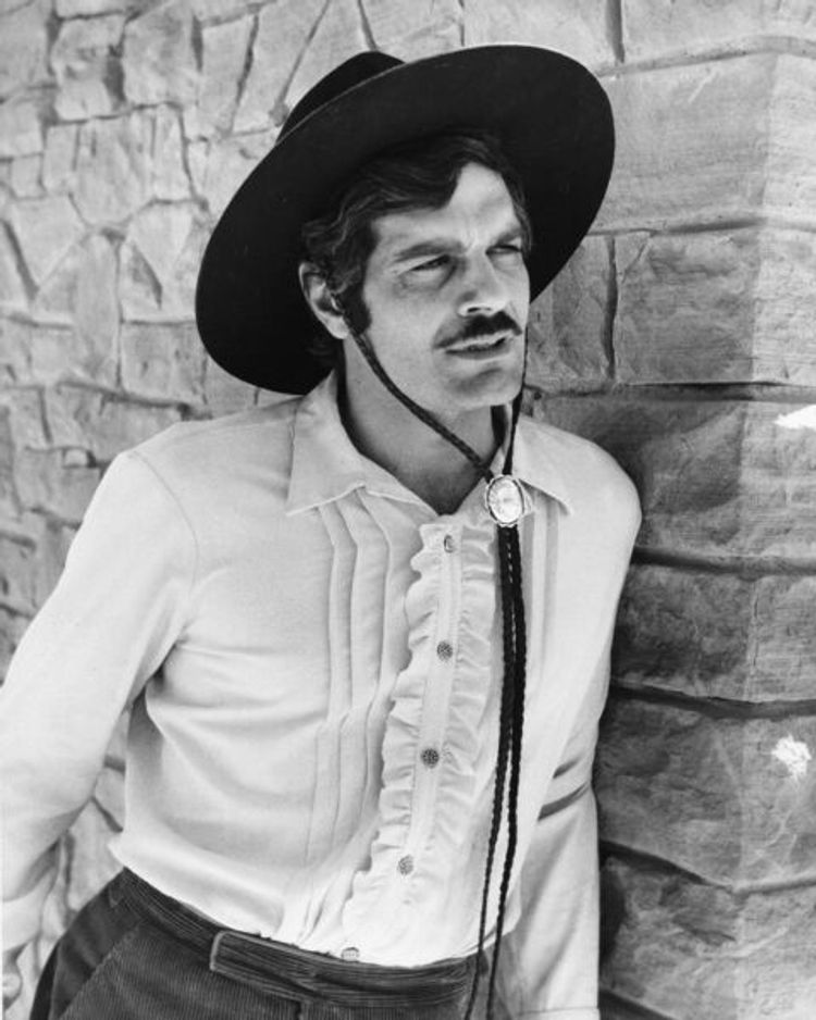 Omar Sharif in a chic cowbot look
