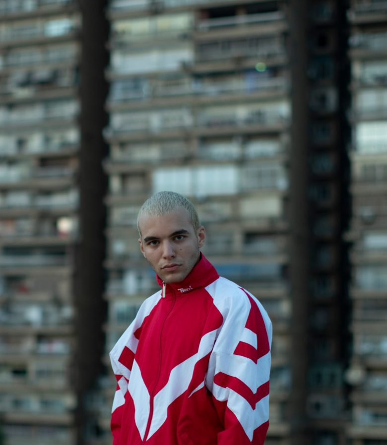 Young man in red tracksuit by Youssef Sherif